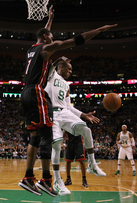 BOSTON, MA - MAY 09:  Rajon Rondo #9 of the Boston Celtics passes the ball as Chris Bosh #1 of the Miami Heat defends in Game Four of the Eastern Conference Semifinals in the 2011 NBA Playoffs on May 9, 2011 at the TD Garden in Boston, Massachusetts.  NOT