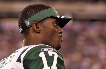 EAST RUTHERFORD, NJ - AUGUST 29:   Plaxico Burress #17 of the New York Jets looks on against the New York Giants during their pre season game on August 29, 2011 at MetLife Stadium in East Rutherford, New Jersey.  (Photo by Jim McIsaac/Getty Images)