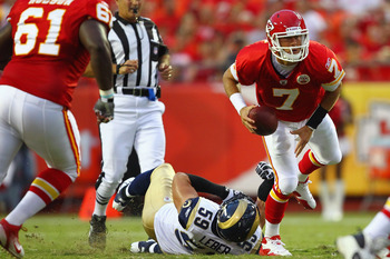 KANSAS CITY, MO - AUGUST 26: Matt Cassel #7 of the Kansas City Chiefs slips out of a tackle attempt by Ben Leber #59 of the St. Louis Rams during a pre-season game at Arrowhead Stadium  on August 26, 2011 in Kansas City, Missouri.  (Photo by Dilip Vishwan