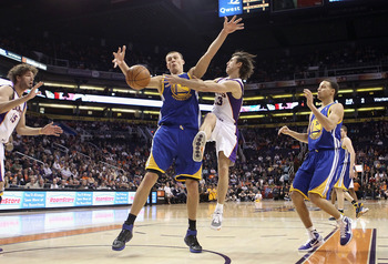 PHOENIX, AZ - FEBRUARY 10:  Steve Nash #13 of the Phoenix Suns passes the ball during the NBA game against the Golden State Warriors at US Airways Center on February 10, 2011 in Phoenix, Arizona.  The Suns defeated the Warriors 112-88.  NOTE TO USER: User