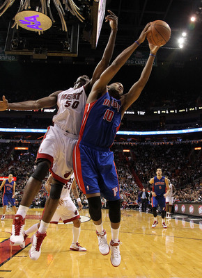 MIAMI, FL - JANUARY 28:  Greg Monroe #10 of of the Detroit Pistons fights for a rebound against Joel Anthony #50 of the Miami Heat during a game at American Airlines Arena on January 28, 2011 in Miami, Florida. NOTE TO USER: User expressly acknowledges an
