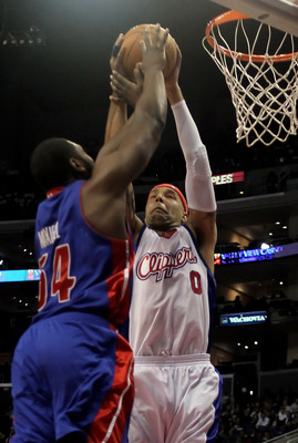LOS ANGELES, CA - FEBRUARY 24:  Drew Gooden #0 of the Los Angeles Clippers and Jason Maxiell #54 of the Detroit Pistons fight for a rebound during the first half at Staples Center on February 24, 2010 in Los Angeles, California. NOTE TO USER: User express