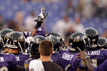 BALTIMORE, MD - AUGUST 25:  Members of the Baltimore Ravens gather before the start of a preseason game against the Washington Redskins at M&T Bank Stadium on August 25, 2011 in Baltimore, Maryland.  (Photo by Rob Carr/Getty Images)