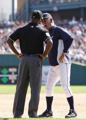 DETROIT - AUGUST 21:  Detroit Tigers manager Jim Leyland #10 argues with third base umpire Tim McClelland #64 after a close play at third base where Wilson Betemit #20 was called out on a sacrifice bunt by Ramon Santiago #39 in the sixth inning of the gam