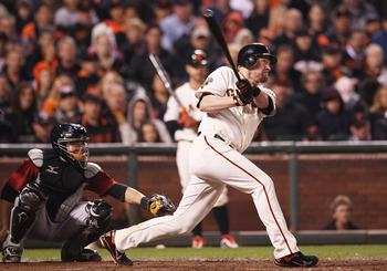 SAN FRANCISCO, CA - AUGUST 27: Aubrey Huff #17 of the San Francisco Giants watches a ball that he hit as it goes into the outfield during a game between the Houston Astros and the San Francisco Giants at AT&T Park on August 27, 2011 in San Francisco, Cali