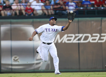 ARLINGTON, TX - AUGUST 28: Nelson Cruz #17 of the Texas Rangers catches a pop fly to right field hit by leadoff hitter Peter Bourjos #25 of the Los Angeles Angels of Anaheim at Rangers Ballpark in Arlington on August 28, 2011 in Arlington, Texas. (Photo b
