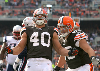 CLEVELAND - NOVEMBER 07:  Running back Peyton Hillis #40 and Alex Mack #55 of the Cleveland Browns celebrate after a touchdown against the New England Patriots at Cleveland Browns Stadium on November 7, 2010 in Cleveland, Ohio.  (Photo by Matt Sullivan/Ge
