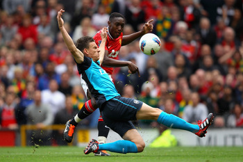 MANCHESTER, ENGLAND - AUGUST 28:  Laurent Koscielny of Arsenal attempts to block the shot by Danny Welbeck of Manchester United during the Barclays Premier League match between Manchester United and Arsenal at Old Trafford on August 28, 2011 in Manchester