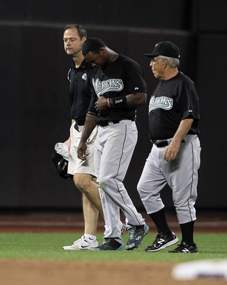 NEW YORK, NY - AUGUST 02:  Hanley Ramirez #2 of the Florida Marlins is helped from the field after injuring himself in the sixth inning against the New York Mets at Citi Field on August 2, 2011 in the Flushing neighborhood of the Queens borough of New Yor