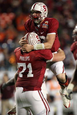 MIAMI, FL - JANUARY 03: Andrew Luck #12 of the Stanford Cardinal with Andrew Phillips #71 celebrates after he threw a 38-yard touchdown pass in the fourth quarter against the Virginia Tech Hokies during the 2011 Discover Orange Bowl at Sun Life Stadium on