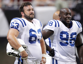 ST. LOUIS, MO - AUGUST 13: Jeff Saturday #63 and Robert Mathis #98 of the Indianapolis Colts look on before the NFL preseason game against the St. Louis Rams at Edward Jones Dome on August 13, 2011 in St. Louis, Missouri. (Photo by Joe Robbins/Getty Image