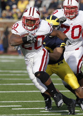 ANN ARBOR, MI - NOVEMBER 20:  James White #20 of the Wisconsin Badgers looks for running room while playing the Michigan Wolverines at Michigan Stadium on November 20, 2010 in Ann Arbor, Michigan. Wisconson won the game 48-28.  (Photo by Gregory Shamus/Ge