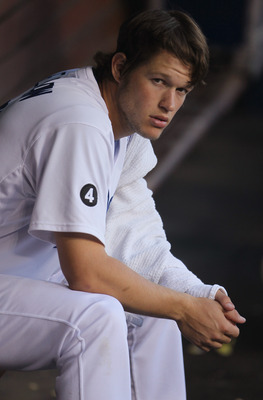 LOS ANGELES, CA - AUGUST 13:  Clayton Kershaw #22 of the Los Angeles Dodgers looks on from the dugout against the Houston Astros at Dodger Stadium on August 13, 2011 in Los Angeles, California.  (Photo by Jeff Gross/Getty Images)