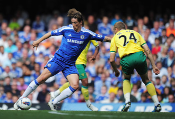 LONDON, ENGLAND - AUGUST 27: Fernando Torres of Chelsea takes on Ritchie De Laet of Norwich City during the Barclays Premier League match between Chelsea and Norwich City at Stamford Bridge on August 27, 2011 in London, England.  (Photo by Shaun Botterill