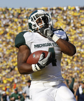 ANN ARBOR, MI - OCTOBER 09: Edwin Baker #4 of the Michigan State Spartans scores on a 61 yard touchdown in the second quarter during the game against the Michigan Wolverines during the game on October 9, 2010 at Michigan Stadium in Ann Arbor, Michigan. Th