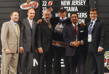RALEIGH, NC - JUNE 26:  (L to R) NHL Commisioner Gary Bettman, unknown scout, Ross Mahoney, #1 overall draft pick Alexander Ovechkin, owner Ted Leonsis and George McPhee of the Washington Capitals during the 2004 NHL Draft on June 26, 2004 at the RBC Cent