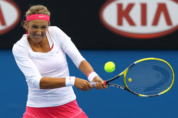 MELBOURNE, AUSTRALIA - JANUARY 17:  Victoria Azarenka of Belarus plays a backhand in her first round match against Kathrin Woerle of Germany during day one of the 2011 Australian Open at Melbourne Park on January 17, 2011 in Melbourne, Australia.  (Photo