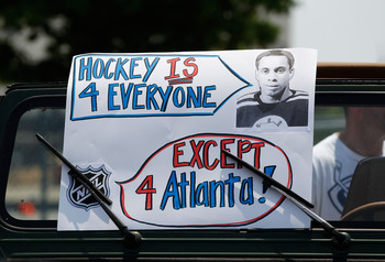 ATLANTA, GA - MAY 21:  Atlanta Thrashers fans rally and put up signs to help keep the team in Atlanta at Philips Arena on May 21, 2011 in Atlanta, Georgia.  It has been reported the Thrashers may relocate to Winnipeg, Canada.  (Photo by Kevin C. Cox/Getty