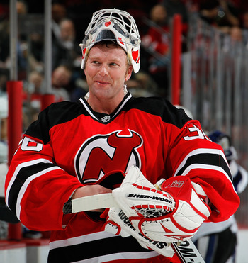 NEWARK, NJ - MARCH 02:  Goalie Martin Brodeur #30 of the New Jersey Devils smiles during a timeout in an NHL hockey game against the Tampa Bay Lightning at the Prudential Center on March 2, 2011 in Newark, New Jersey.  (Photo by Paul Bereswill/Getty Image