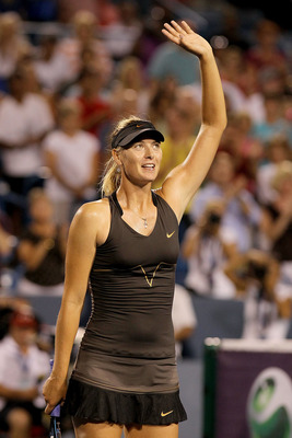 MASON, OH - AUGUST 20:  Maria Sharapova of Russia acknowledges the crowd after her win over Vera Zvonareva of Russia during the Western & Southern Open at the Lindner Family Tennis Center on August 20, 2011 in Mason, Ohio.  (Photo by Matthew Stockman/Gett