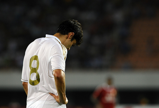 GUANGZHOU, CHINA - AUGUST 03:  Kaka of Real Madrid reacts during the pre-season friendly match between Guangzhou Evergrande and Real Madrid at the Tianhe Stadium on August 3, 2011 in Guangzhou, China. (Photo by Victor Fraile/Getty Images)