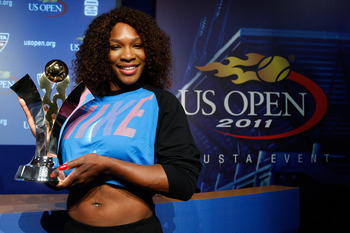 NEW YORK, NY - AUGUST 29:  Serena Williams of the United States poses with the Olympus US Open Series Trophy at a press conference during Day One of the 2011 US Open at the USTA Billie Jean King National Tennis Center on August 29, 2011 in the Flushing ne