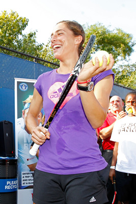 NEW YORK, NY - AUGUST 26:  Andrea Petkovic of Germany cheers after taking part in a Guinness World Record attempt for the most people to bounce a tennis ball on their racquet in one location prior to the start of the 2011 U.S. Open at the USTA Billie Jean