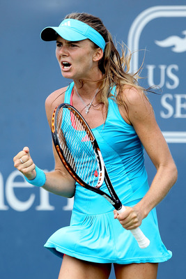 MASON, OH - AUGUST 18:  Daniela Hantuchova of Slovakia celebrates match point against Marion Bartoli of France during the Western & Southern Open at the Lindner Family Tennis Center on August 18, 2011 in Mason, Ohio.  (Photo by Matthew Stockman/Getty Imag