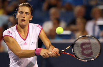 MASON, OH - AUGUST 20:  Andrea Petkovic of Germany returns a shot to Jelena Jankovic of Serbia during the Western & Southern Open at the Lindner Family Tennis Center on August 20, 2011 in Mason, Ohio.  (Photo by Elsa/Getty Images)