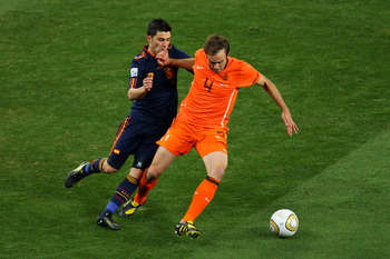 JOHANNESBURG, SOUTH AFRICA - JULY 11:  David Villa of Spain closed down Joris Mathijsen of the Netherlands during the 2010 FIFA World Cup South Africa Final match between Netherlands and Spain at Soccer City Stadium on July 11, 2010 in Johannesburg, South