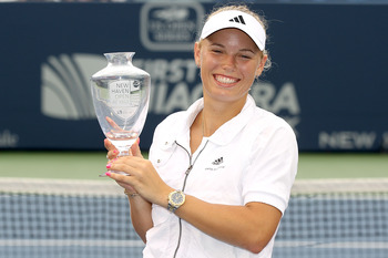 NEW HAVEN, CT - AUGUST 27:  Caroline Wozniacki of Denmark poses with the winner's trophy after defeating Petra Cetkovska of the Czech Republic during the final of the New Haven Open at Yale presented by First Niagara at the Connecticut Tennis Center on Au