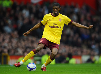 MANCHESTER, ENGLAND - MARCH 12:  Abou Diaby of Arsenal passes the ball during the FA Cup sponsored by E.On Sixth Round match between Manchester United and Arsenal at Old Trafford on March 12, 2011 in Manchester, England.  (Photo by Clive Mason/Getty Image