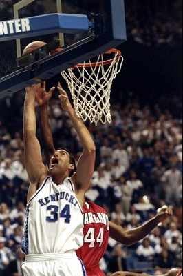 12 Dec 1998:  Forward Scott Padgett #34 of the Kentucky Wildcats in action against forward Terence Morris #44 of the Maryland Terrapins during a game at the Rupp Arena in Lexington, Kentucky.  Kentucky defeated Maryland 103-91. Mandatory Credit: Mark Lyon