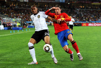DURBAN, SOUTH AFRICA - JULY 07:  Jerome Boateng of Germany and Sergio Ramos of Spain battle for the ball during the 2010 FIFA World Cup South Africa Semi Final match between Germany and Spain at Durban Stadium on July 7, 2010 in Durban, South Africa.  (Ph
