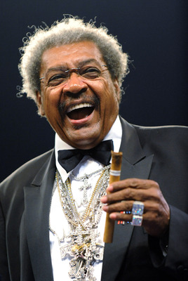 CARSON, CA - SEPTEMBER 27:  Don King smiles with a cigar after the Shane Mosley and Ricardo Mayorga junior middleweight bout at the Home Depot Center on September 27, 2008 in Carson, California.  (Photo by Harry How/Getty Images)