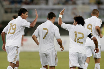 TIANJIN, CHINA - AUGUST 06: Raphael Varane (L) and Marcelo of Real Madrid celebrate a goal during the pre-season friendly match between Tianjin Teda and Real Madrid at Water Drop Stadium on August 6, 2011 in Tianjin, China. (Photo by Lintao Zhang/Getty Im