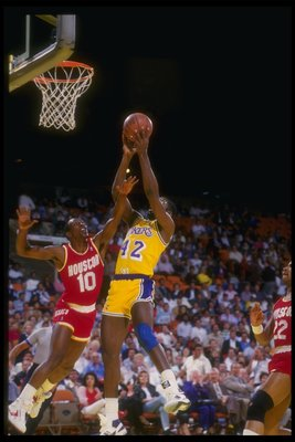 1987:  Dirk Minniefield of the Los Angeles Lakers goes up for two during a game against the Houston Rockets at the Great Western Forum in Inglewood, California. Mandatory Credit: Mike Powell  /Allsport Mandatory Credit: Mike Powell  /Allsport