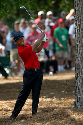 AUGUSTA, GA - APRIL 10:  Tiger Woods hits from the pine needles during the final round of the 2011 Masters Tournament at Augusta National Golf Club on April 10, 2011 in Augusta, Georgia.  (Photo by Jamie Squire/Getty Images)