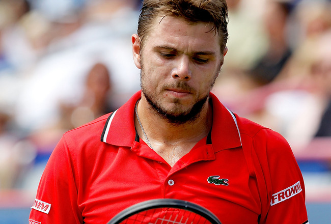 MONTREAL, QC - AUGUST 12: Stanislas Wawrinka of Switzlerland checks his racquet between points while playing Mardy Fish of the United States during the Rogers Cup at Uniprix Stadium on August 12, 2011 in Montreal, Canada.  (Photo by Matthew Stockman/Getty