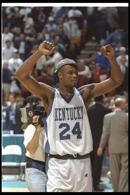 1 Apr 1996:  Forward Antoine Walker of the Kentucky Wildcats celebrates during a game against the Syracuse Orangemen at the Meadowlands Arena in East Rutherford, New Jersey.  Kentucky won the game, 76-67. Mandatory Credit: Doug Pensinger  /Allsport