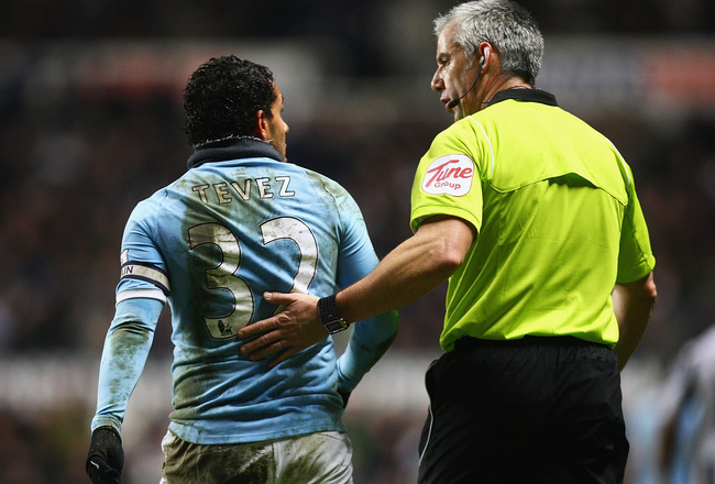 NEWCASTLE UPON TYNE, ENGLAND - DECEMBER 26:  Carlos Tevez of Manchester City talks to referee Chris Hoy during the Barclays Premier League match between Newcastle United and Manchester City at St James' Park on December 26, 2010 in Newcastle upon Tyne, En