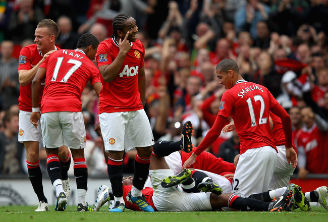 MANCHESTER, ENGLAND - AUGUST 28:  Anderson of Manchester United celebrates with team mates after Wayne Rooney scores his side's third goal during the Barclays Premier League match between Manchester United and Arsenal at Old Trafford on August 28, 2011 in