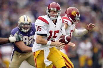 SEATTLE - SEPTEMBER 19:  Quarterback Aaron Corp #15 of the USC Trojans looks to hand off the ball during the game against the Washington Huskies on September 19, 2009 at Husky Stadium in Seattle, Washington. The Huskies defeated the Trojans 16-13. (Photo