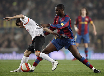 BARCELONA, SPAIN - FEBRUARY 27:  Yaya Toure (R) of Barcelona duels for the ball with David Silva of Valencia during the Copa del Rey semi final match between Barcelona and Valencia at the Camp Nou Stadium on February 27, 2008 in Barcelona, Spain.  (Photo