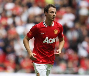 LONDON, ENGLAND - AUGUST 07:  Jonny Evans of Manchester United in action during the FA Community Shield match sponsored by McDonald's between Manchester City and Manchester United at Wembley Stadium on August 7, 2011 in London, England.  (Photo by Clive R