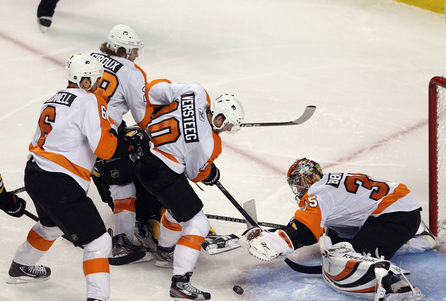 BOSTON, MA - MAY 06: Sean O'Donnell #6, Claude Giroux #28, Kris Versteeg #10, and Sergei Bobrovsky #35 of the Philadelphia Flyers defend the net against the Boston Bruins in Game Four of the Eastern Conference Semifinals during the 2011 NHL Stanley Cup Pl
