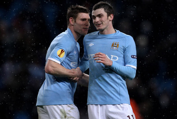 MANCHESTER, ENGLAND - DECEMBER 01:  Adam Johnson (R) of Manchester City celebrates with team mate James Milner at the end of the UEFA Europa League Group A match between Manchester City and FC Salzburg at the City of Manchester Stadium on December 1, 2010