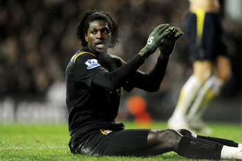 LONDON, ENGLAND - DECEMBER 16:  A frustrated Emmanuel Adebayor of Manchester City reacts after a missed chance during the Barclays Premier League match between Tottenham Hotspur and Manchester City at White Hart Lane on December 16, 2009 in London, Englan