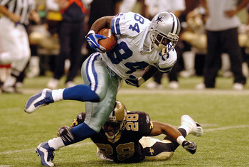 NEW ORLEANS - DECEMBER 28:  Wide receiver Joey Galloway #84 of the Dallas Cowboys evades cornerback Deveron Harper #28 of the New Orleans Saints during the game at the Superdome on December 28, 2003 in New Orleans, Louisiana. The Saints defeated the Cowbo