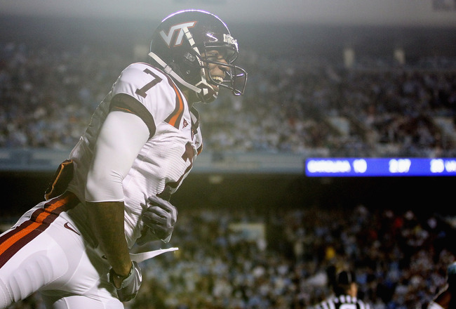 CHAPEL HILL, NC - NOVEMBER 13:  Marcus Davis #7 of the Virginia Tech Hokies celebrates after scoring a touchdown against the North Carolina Tar Heels during their game at Kenan Stadium on November 13, 2010 in Chapel Hill, North Carolina.  (Photo by Street